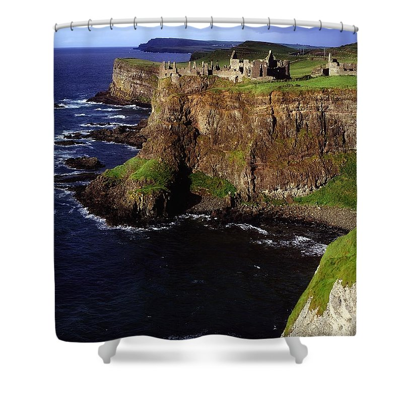 Architectural Exteriors Shower Curtain featuring the photograph Dunluce Castle, Co. Antrim, Ireland by The Irish Image Collection