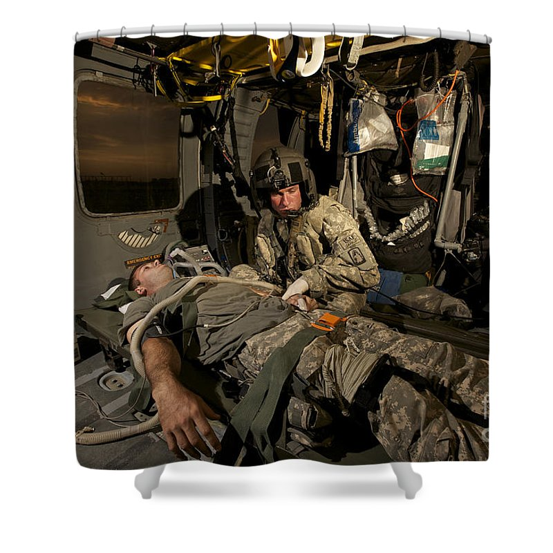 Blackhawk Shower Curtain featuring the photograph U.s. Army Specialist Practices Giving by Terry Moore