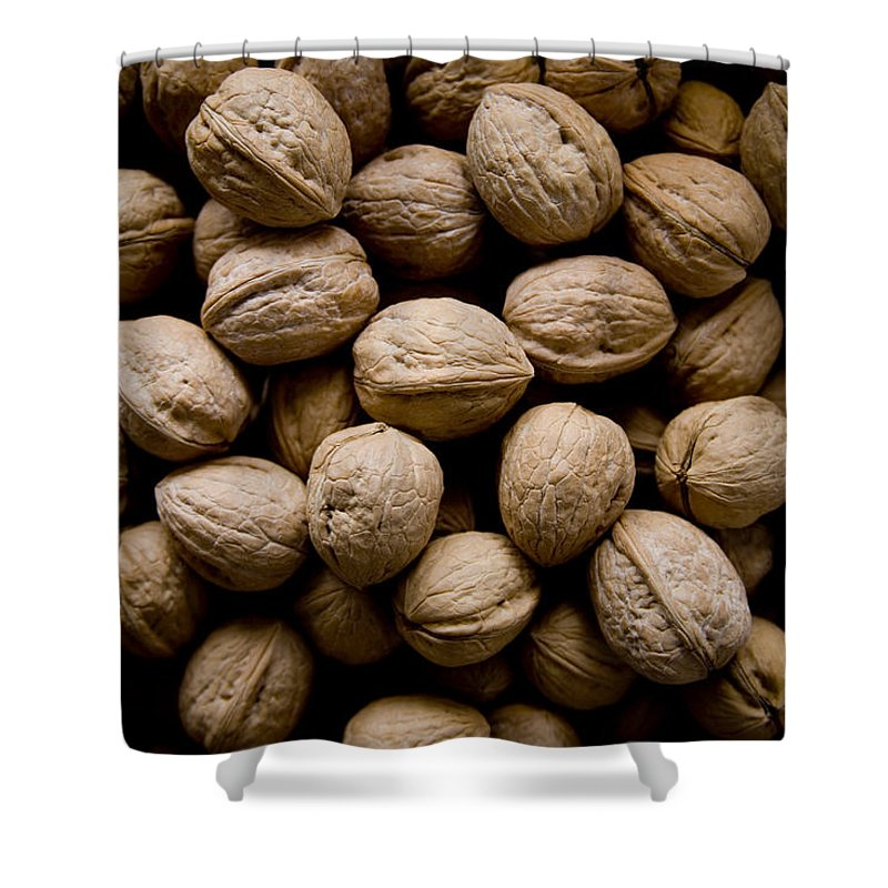 Harpers Ferry Shower Curtain featuring the photograph A Bin Of Walnuts At A Fruit Stand by Stephen St. John