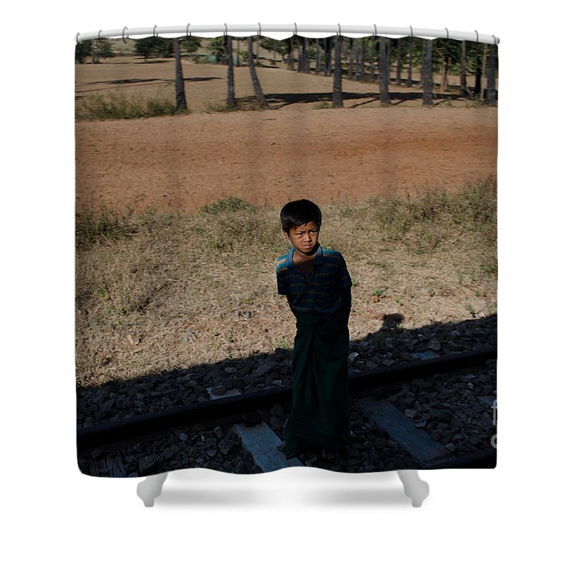 Asia Shower Curtain featuring the photograph A Boy In Burma Looks Towards A Train From The Shadows by Jason Rosette