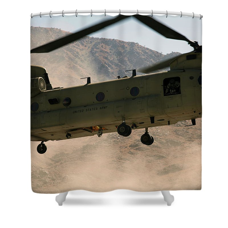 Operation Enduring Freedom Shower Curtain featuring the photograph A Ch-47 Chinook Helicopter Kicks by Stocktrek Images