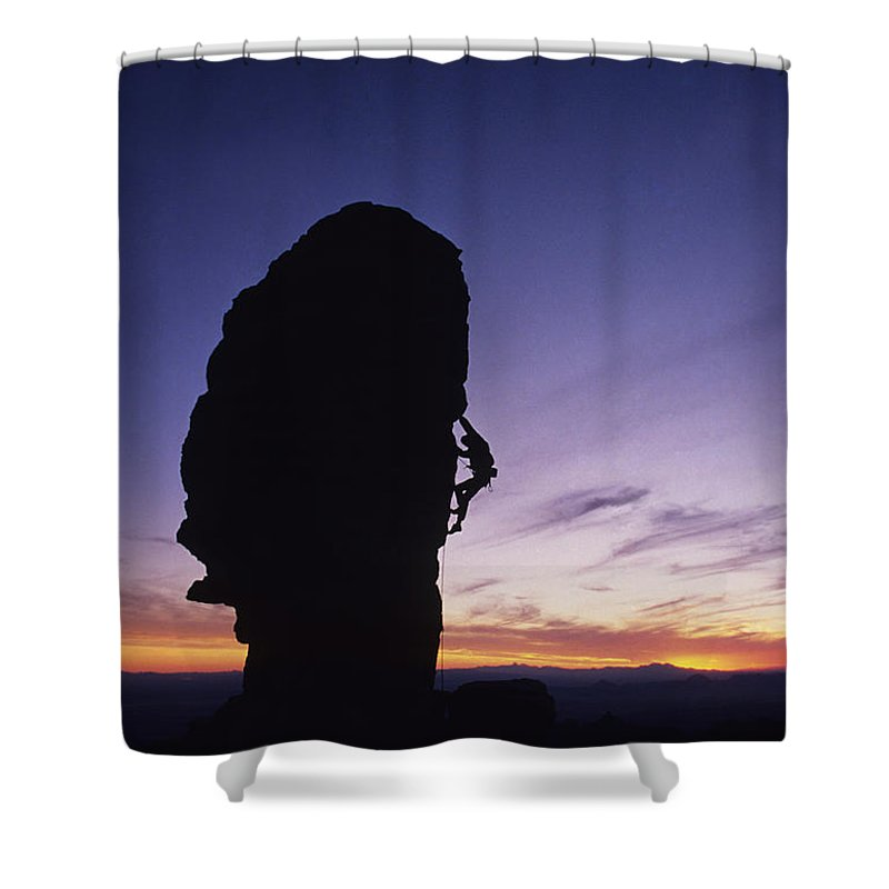 One Person Shower Curtain featuring the photograph A Climber Leads A Route Up A Spire by Bill Hatcher