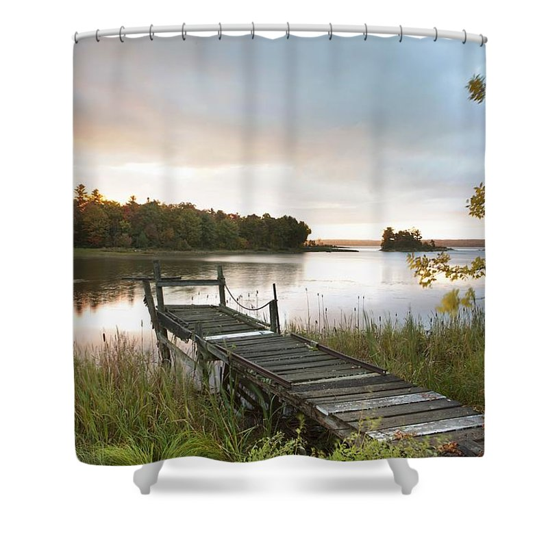 Sunrise Shower Curtain Featuring The Photograph A Dock On Lake At Near Wawa By