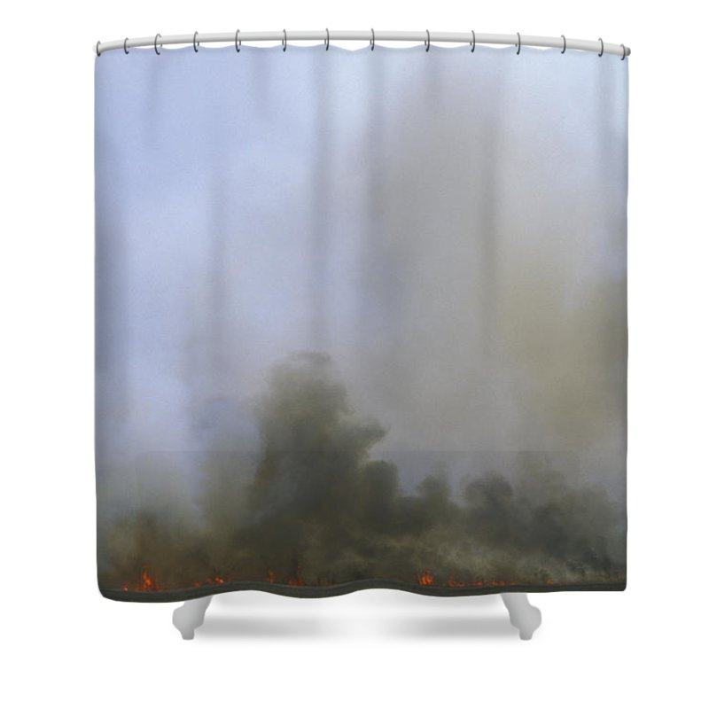 Fire Shower Curtain featuring the photograph A Fire Burns In The Marsh On Ocracoke by Stephen Alvarez