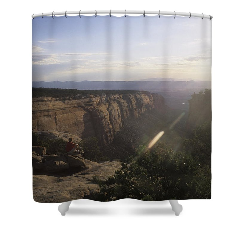 Colorado Plateau Shower Curtain featuring the photograph A Man Admires The Sunset From A Canyon by Taylor S. Kennedy
