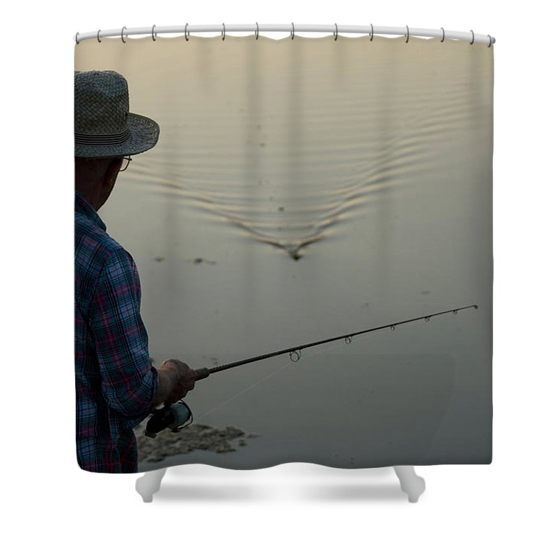 Photography Shower Curtain featuring the photograph A Man Fishes For Largemouth Bass by Joel Sartore