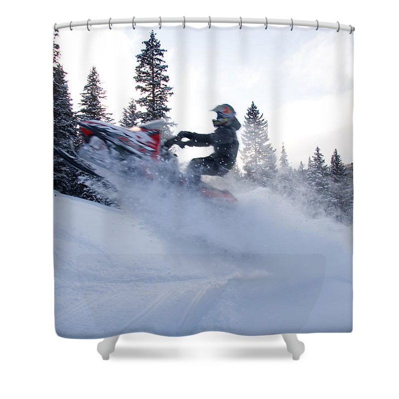 Snowmobiles Shower Curtain featuring the photograph A Man Jumps Across A Road by Taylor S. Kennedy