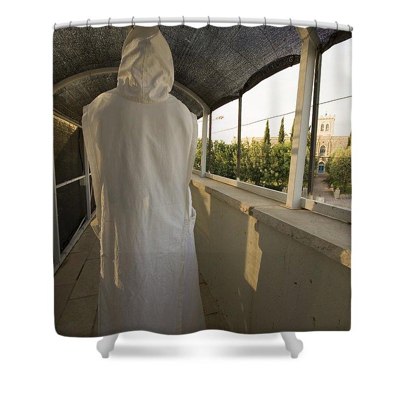 Nun Shower Curtain featuring the photograph A Nun In A Monastery by Danny Yanai