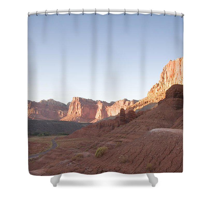 Erosion Shower Curtain featuring the photograph A Road Snakes Through The Parks Cliffs by Taylor S. Kennedy
