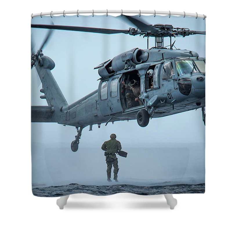 Military Shower Curtain featuring the painting A Sailor Jumps From An Mh-60 Sea Hawk Helicopter Off The Coast Of Guam.  by Celestial Images