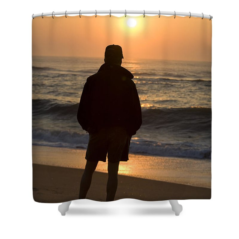 Avon Hatteras Island Shower Curtain featuring the photograph A Silhouetted Figure Enjoys The Ocean by Stephen St. John