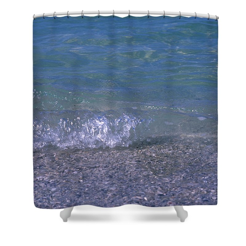 Holmes Beach Shower Curtain featuring the photograph A Small Wave Ripples Onto Shore by Stacy Gold