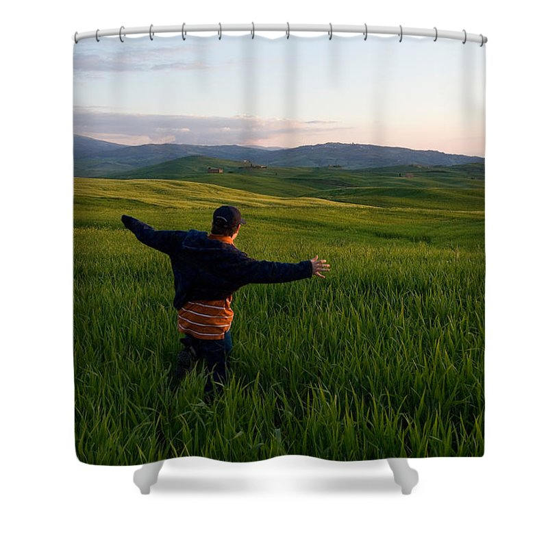 Photography Shower Curtain featuring the photograph A Young Boy Runs Through A Field by Joel Sartore