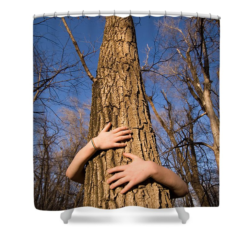 Photography Shower Curtain featuring the photograph A Young Girl Wraps Her Arms by Joel Sartore