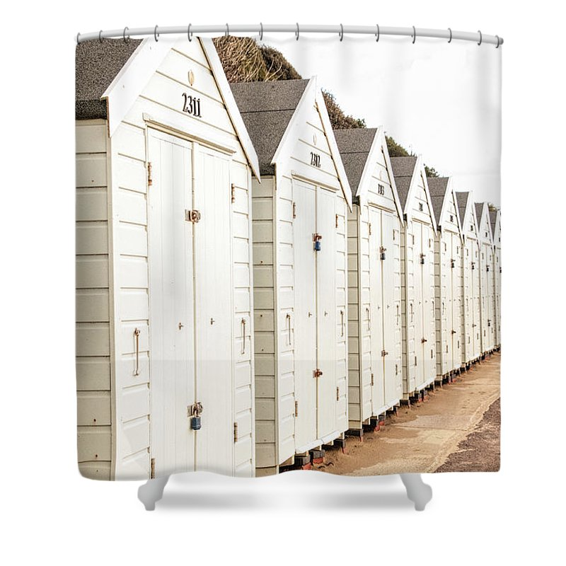 All In A Row Shower Curtain featuring the photograph All In A Row by Phyllis Taylor