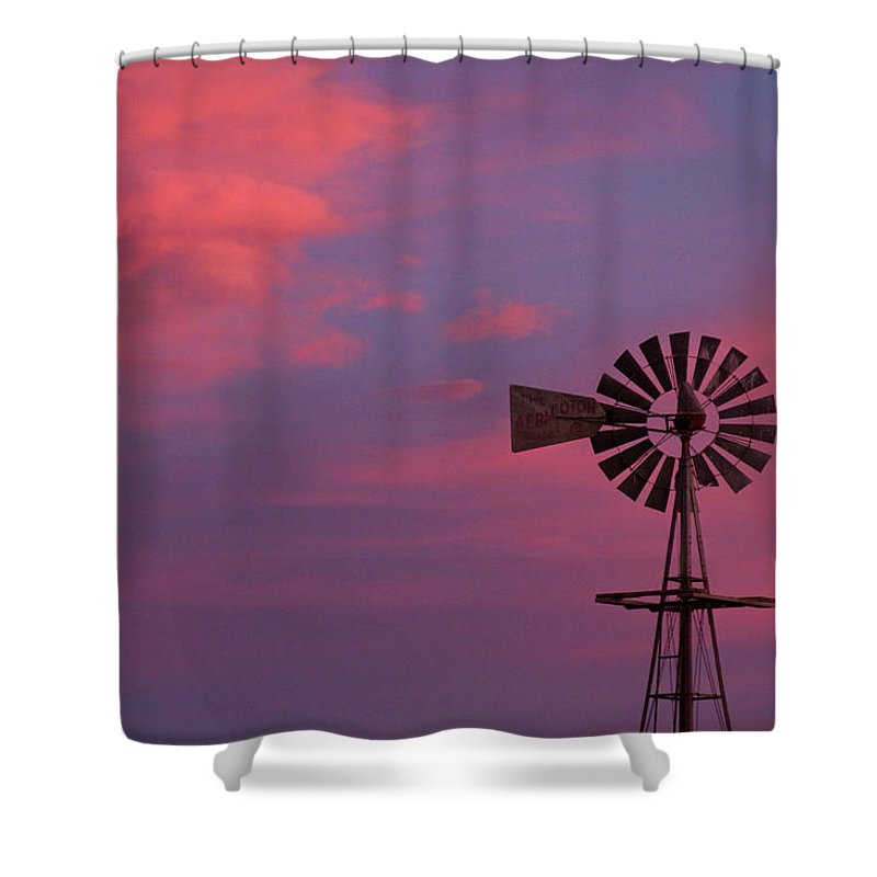 Windmills Shower Curtain featuring the photograph American Old Farm Water Pumping Windmill With A Sunset by James BO Insogna