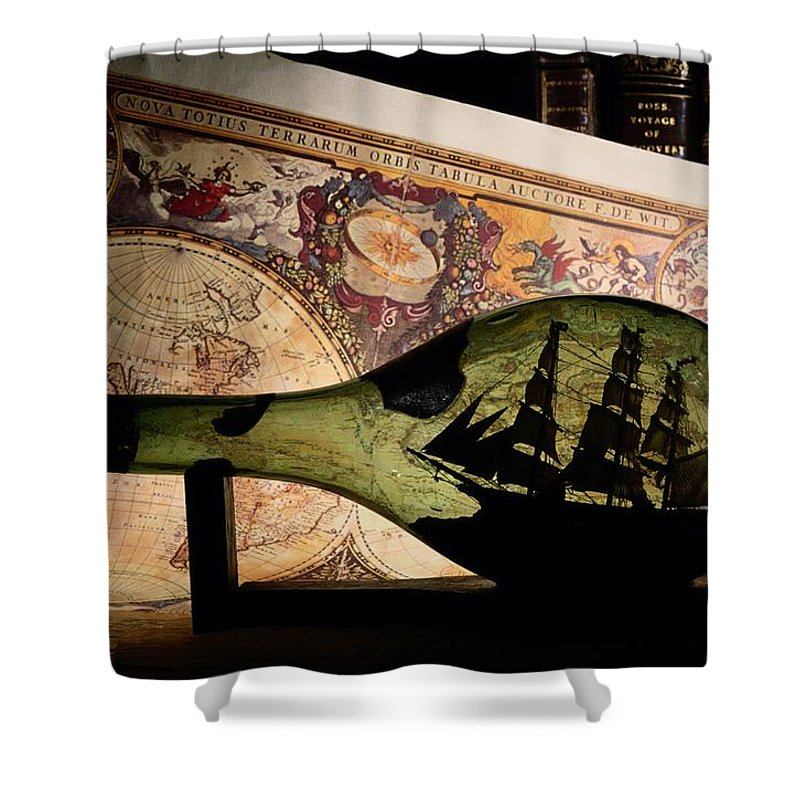 Studio Shot Shower Curtain featuring the photograph An Antique Map Provides The Backdrop by Todd Gipstein