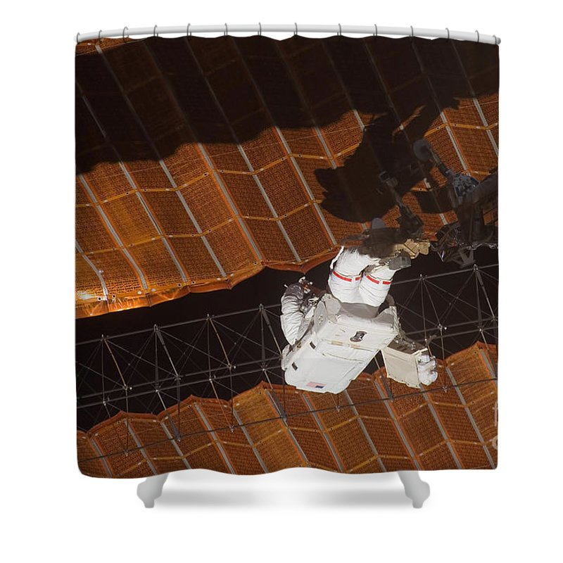 Adults Only Shower Curtain featuring the photograph An Astronaut Anchored To A Foot by Stocktrek Images