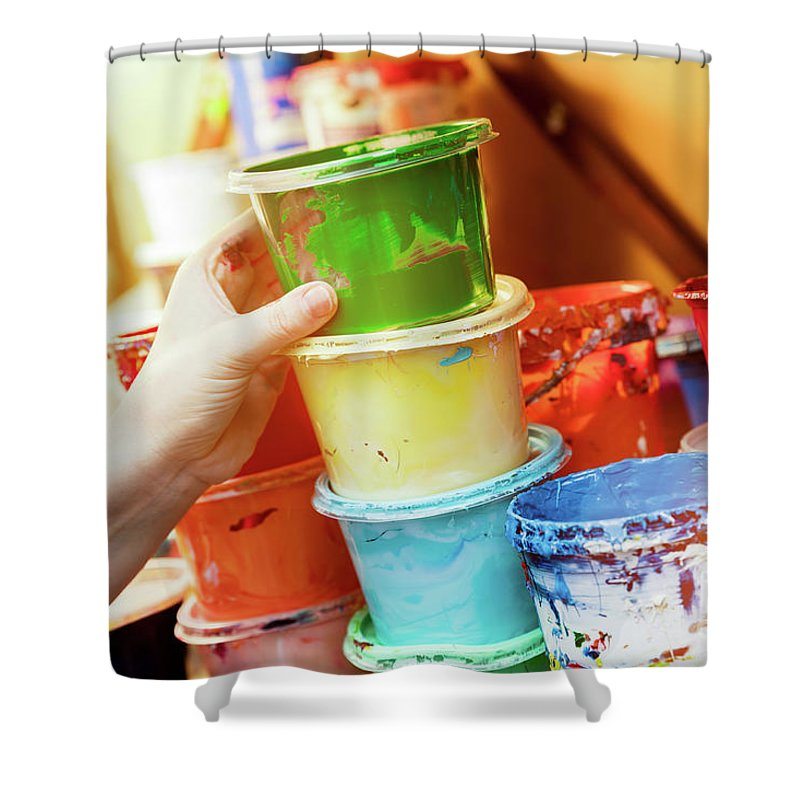 Artist Shower Curtain featuring the photograph Artist Reaching For A Liquid Paint Container. by Michal Bednarek