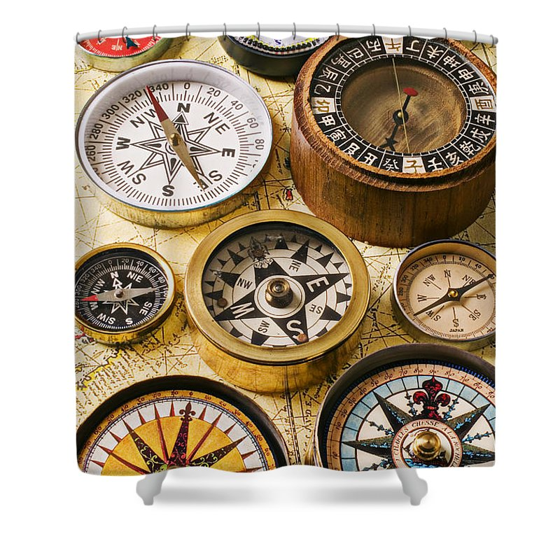 Compass Shower Curtain featuring the photograph Assorted Compasses by Garry Gay