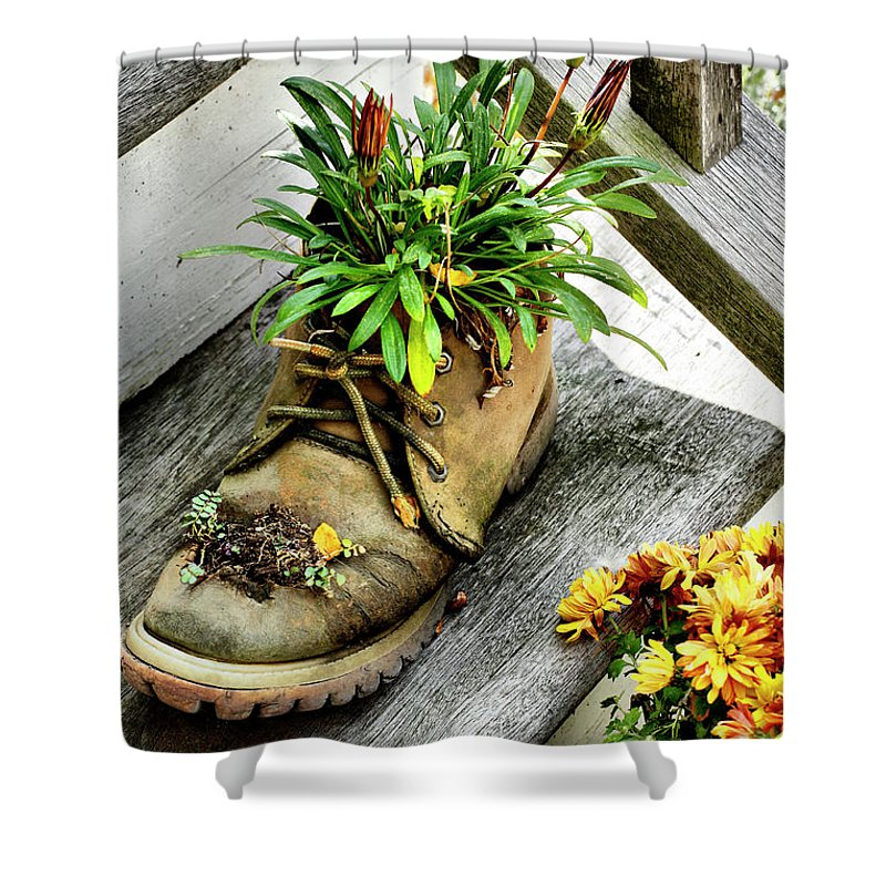 Boot Shower Curtain featuring the photograph Booted Plant by Cate Franklyn