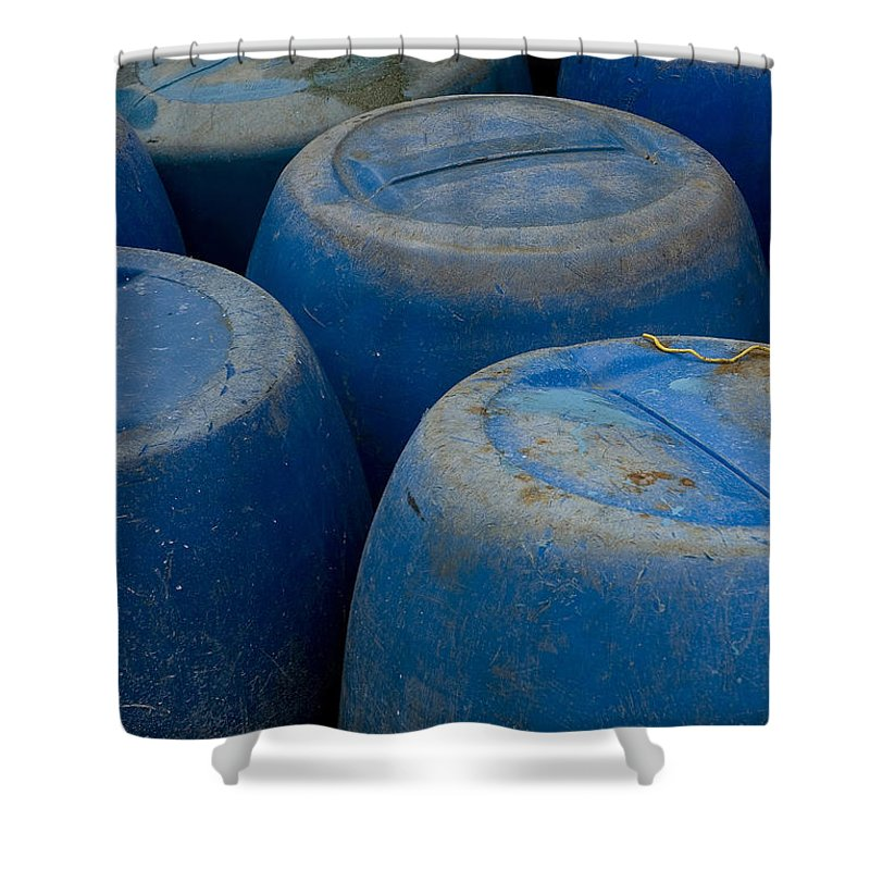 Photography Shower Curtain featuring the photograph Brightly Colored Blue Barrels by Todd Gipstein