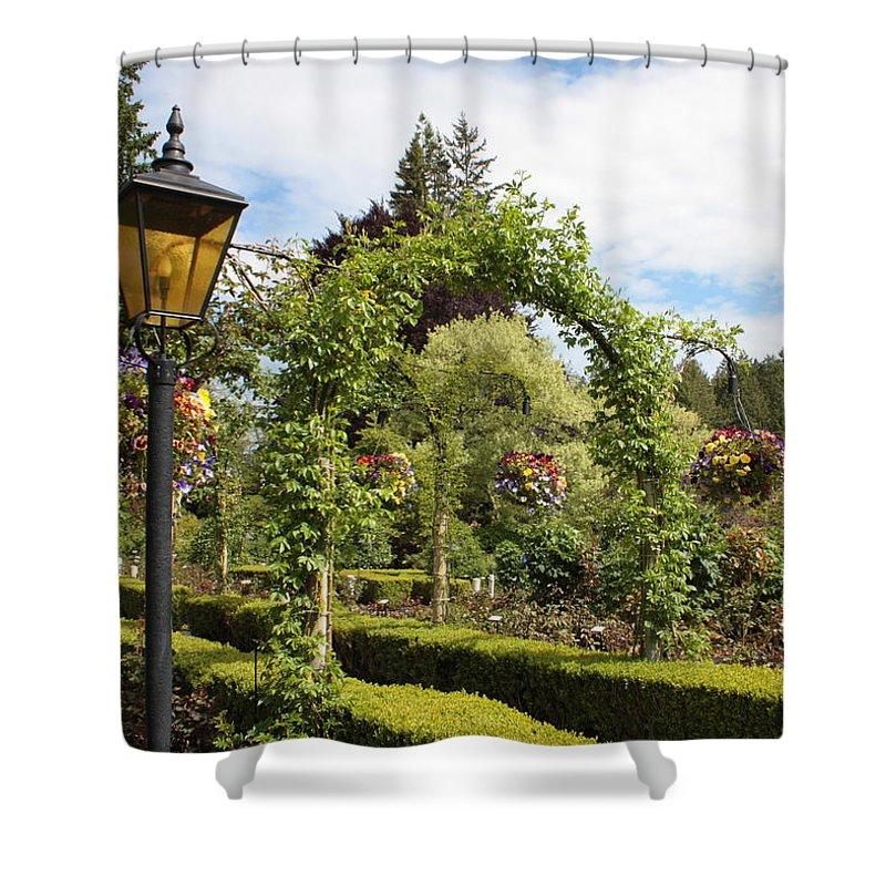 Butchart Gardens Shower Curtain featuring the photograph Butchart Gardens Arches by Carol Groenen