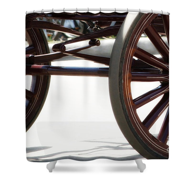 Carriage Shower Curtain featuring the photograph Carriage Wheels by Linda Shafer