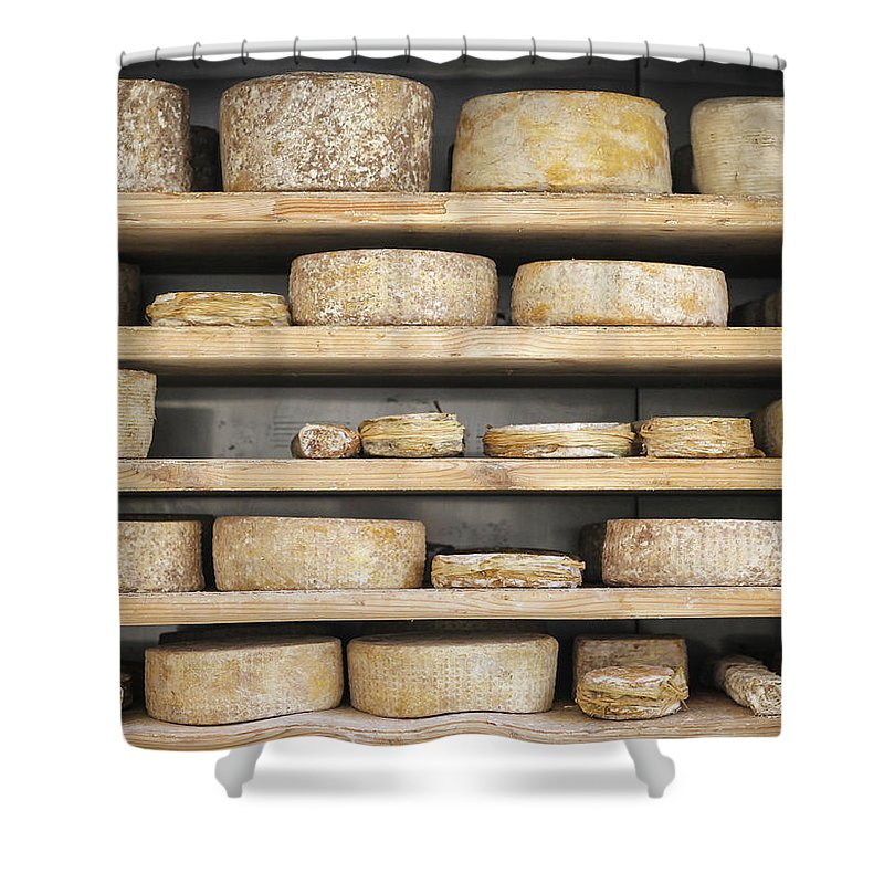 Cheese Shower Curtain featuring the photograph Cheese Wheels On Wooden Shelves In The Cheese Store by Benyamin Shoham