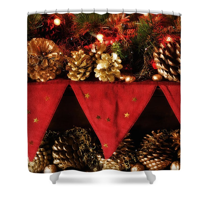 Christmas Shower Curtain featuring the photograph Christmas Decorations Of Garlands And Pine Cones by Mal Bray
