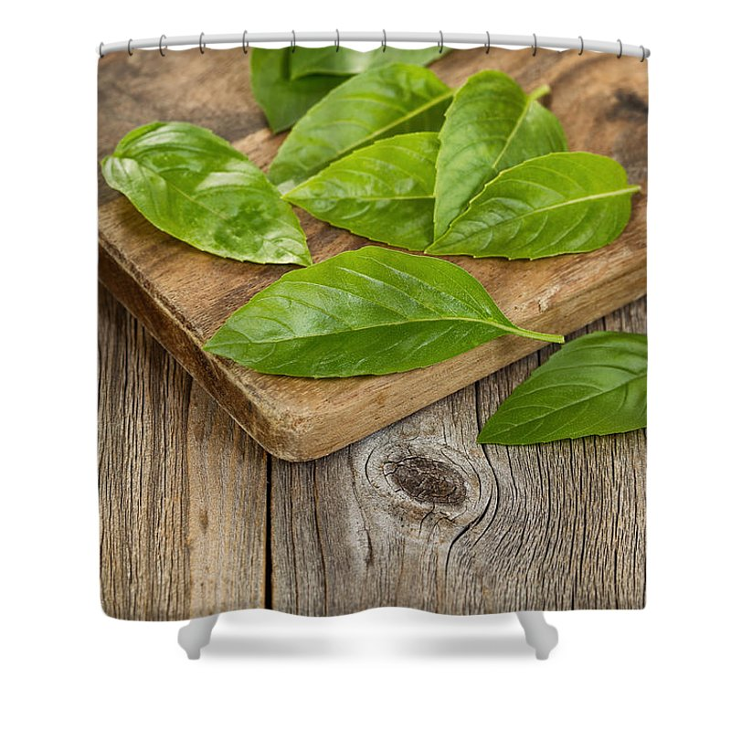 Basil Shower Curtain featuring the photograph Close Up Fresh Basil Leafs On Rustic Serving Board by Thomas Baker