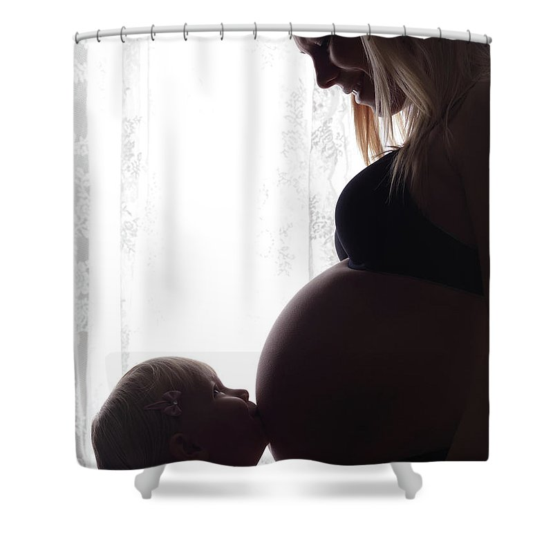 Pregnant Shower Curtain featuring the photograph Daughter Kissing Her Pregnant Mother's Belly by Oleksiy Maksymenko