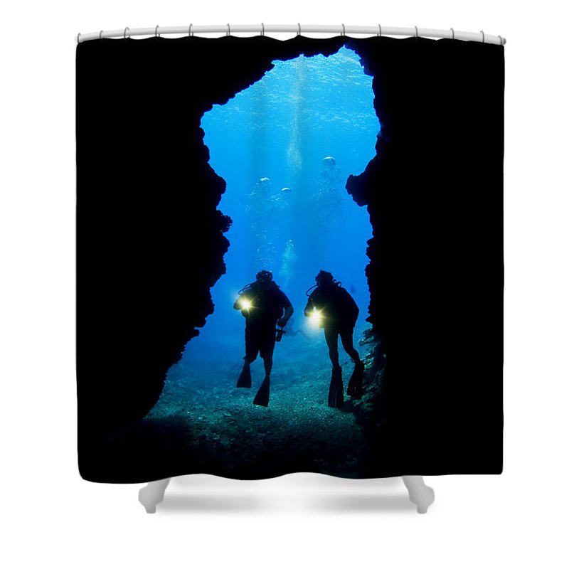 Beautiful Shower Curtain featuring the photograph Divers Silhouetted Through Reef by Dave Fleetham - Printscapes