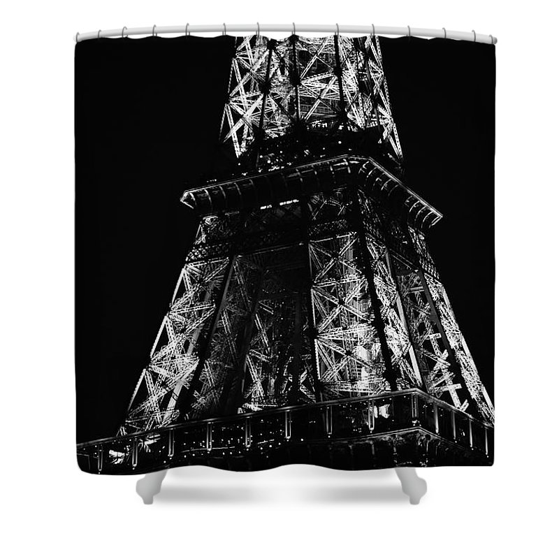 Travelpixpro Shower Curtain featuring the photograph Eiffel Tower Illuminated Midsection At Night Paris France Black And White by Shawn O'Brien