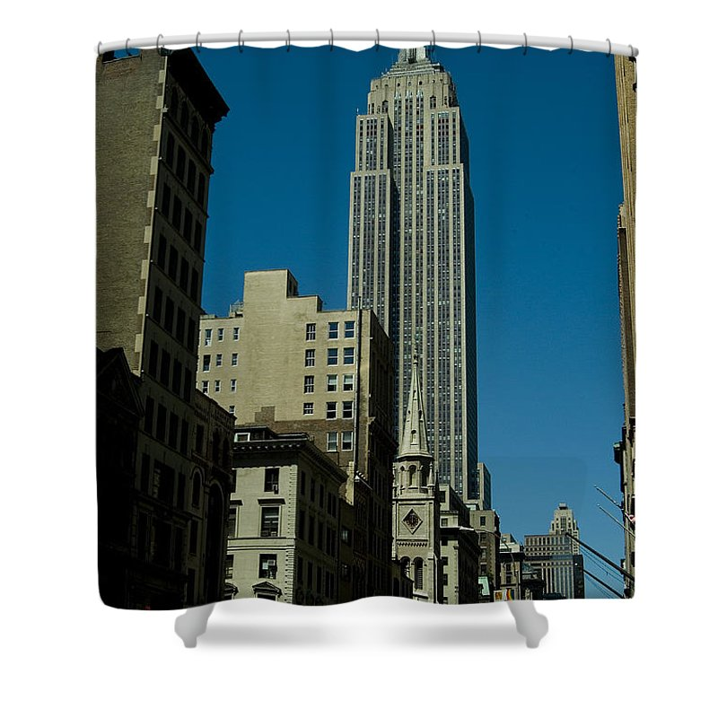 New York City Shower Curtain featuring the photograph Empire State Building Seen From Street by Todd Gipstein