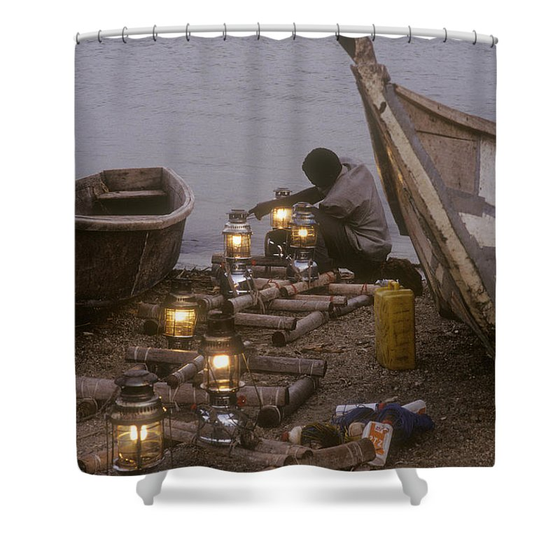 Uganda Shower Curtain featuring the photograph Fisherman Prepares Lanterns For Night by Michael S. Lewis