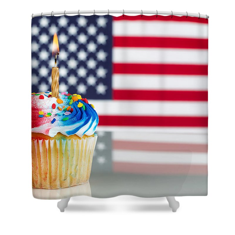 Holiday Shower Curtain featuring the photograph Fourth Of July Cupcake With Light Candle by Thomas Baker