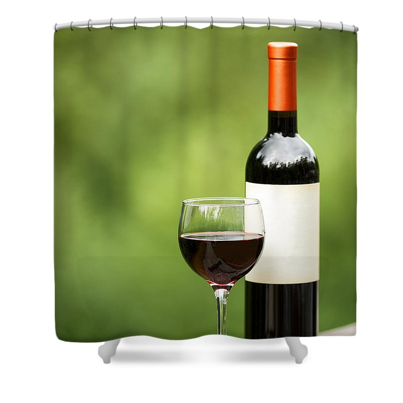 Wine Shower Curtain featuring the photograph Glass Of Red Wine Outdoors Ready To Enjoy by Thomas Baker