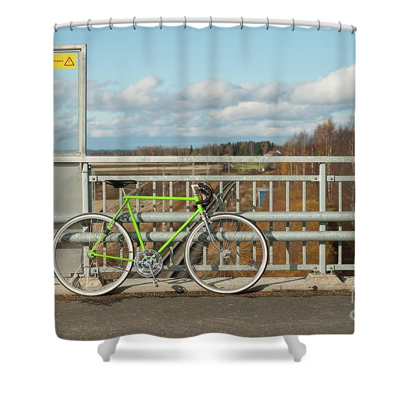 Bicycle Shower Curtain featuring the photograph Green Bicycle On Bridge by Ilari