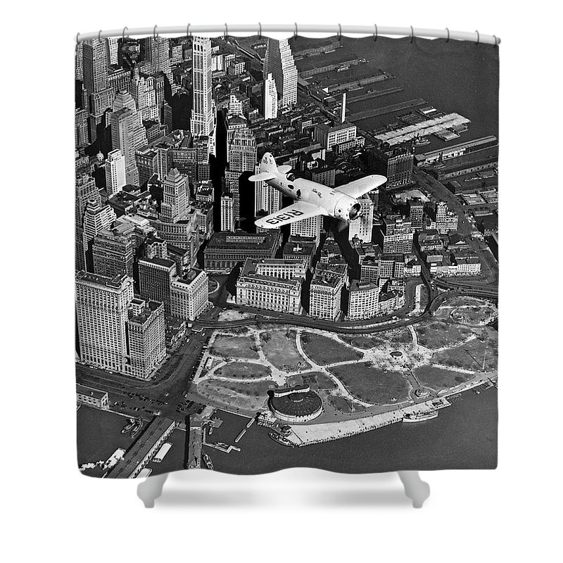 1930's Shower Curtain featuring the photograph Hawk's Plane Over Battery Park by Underwood Archives