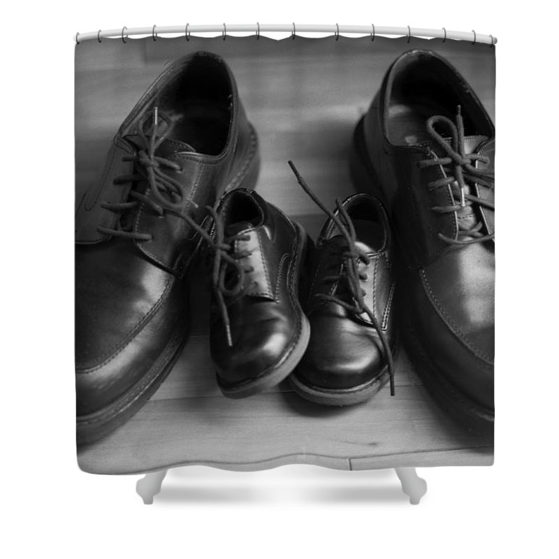 Black And White Shower Curtain featuring the photograph In Their Shoes by Ayesha Lakes