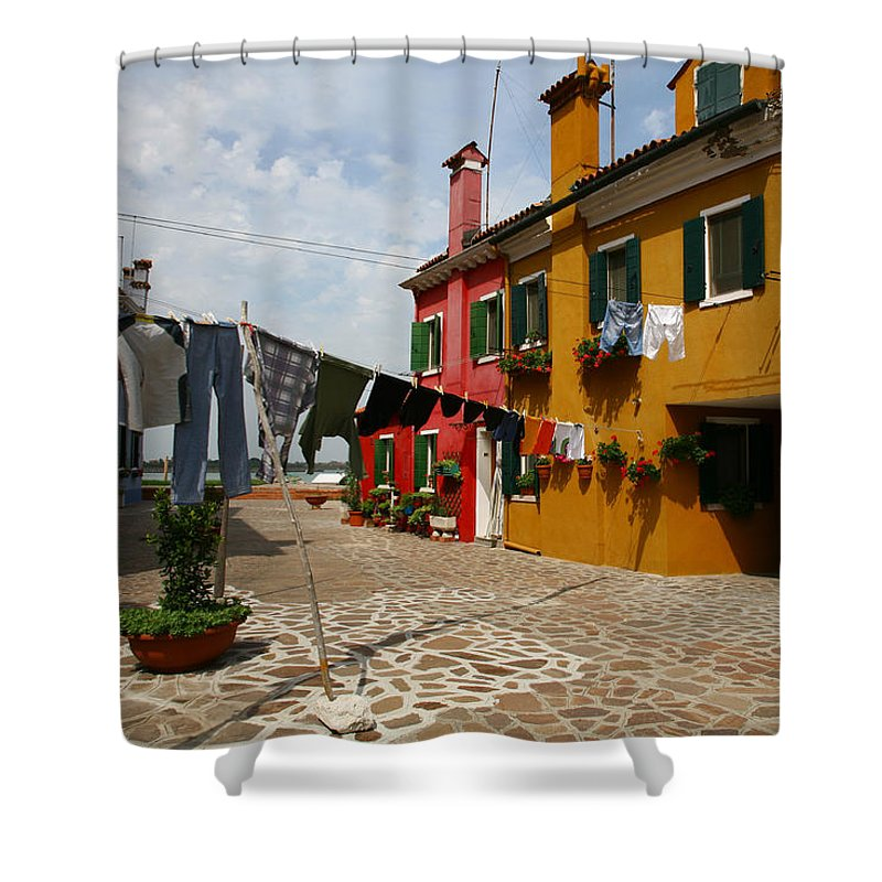Laundry Shower Curtain featuring the photograph Laundry Held By Wooden Pole by Donna Corless