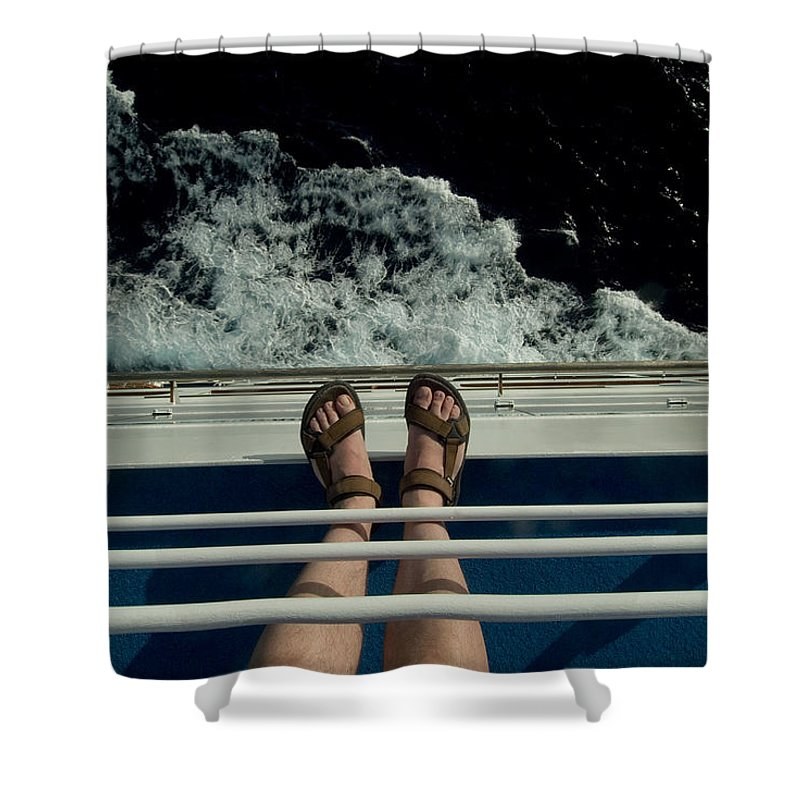 Caribbean Sea Shower Curtain featuring the photograph Mans Feet In Sandals Standing by Todd Gipstein