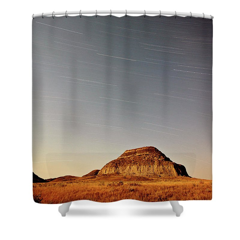 Castle Butte Shower Curtain featuring the digital art Moon Lit Castle Butte And Star Tracks In Scenic Saskatchewan by Mark Duffy