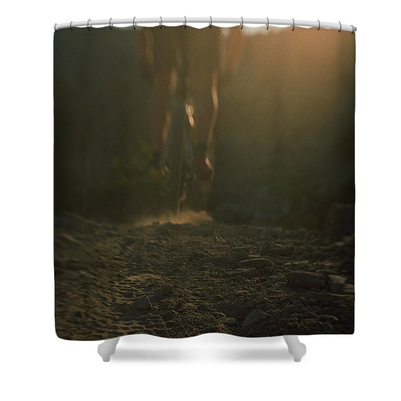 Adventure Sports Shower Curtain featuring the photograph Mountain Bike Tracks And Mountain Biker by Bobby Model