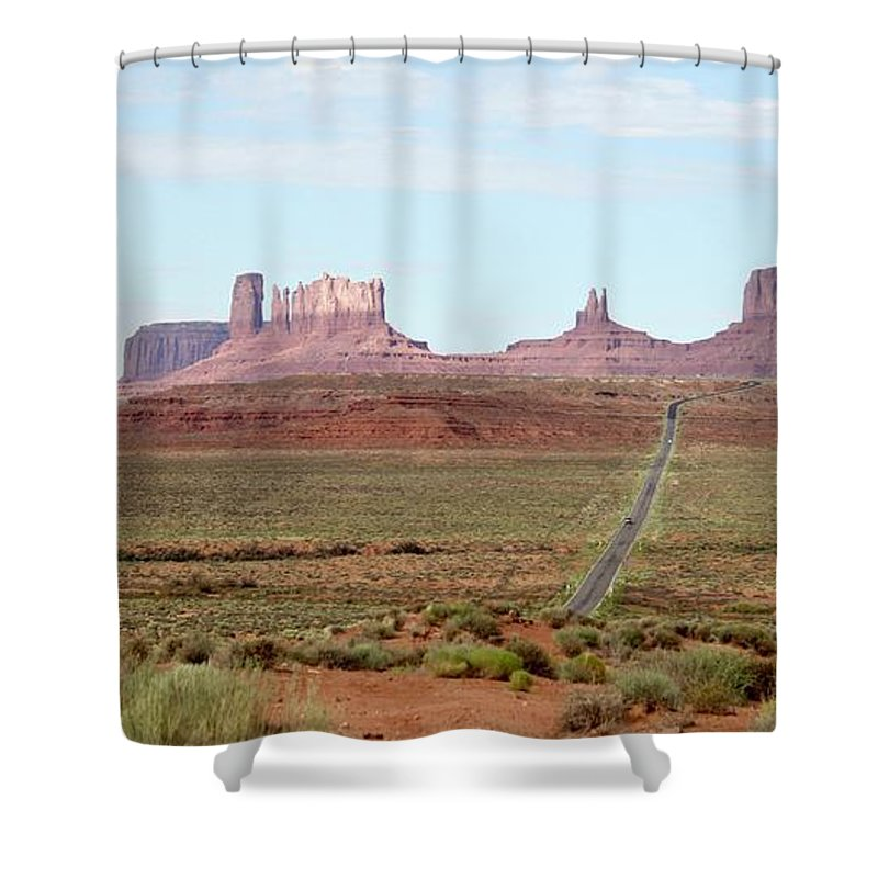 Navajo Shower Curtain featuring the photograph Navajo Flag At Monument Valley by Suzanne Oesterling