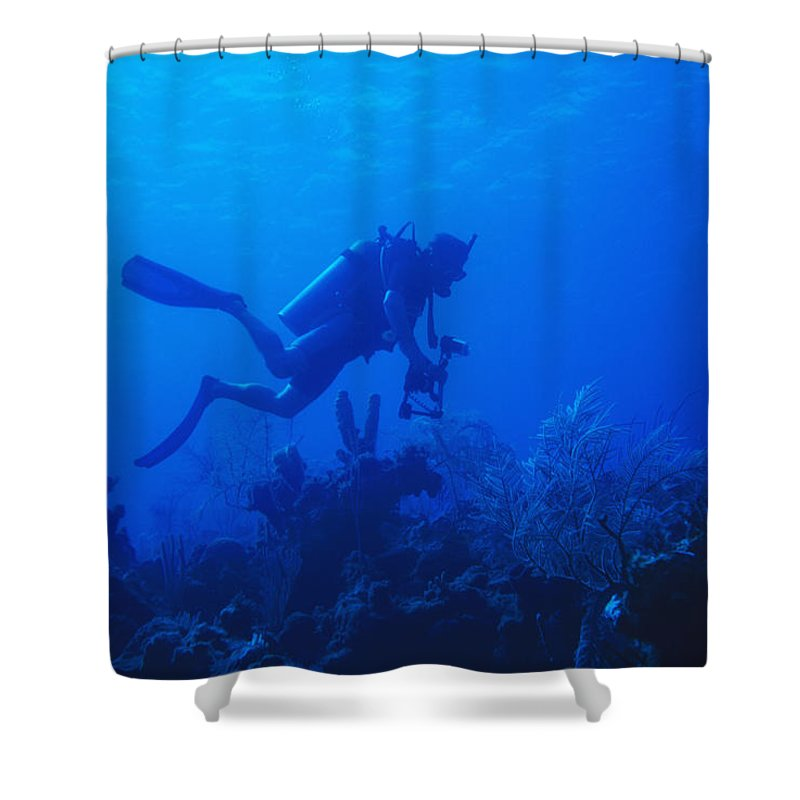 1 Person Shower Curtain featuring the photograph One Man Scuba Diving On Coral Reef by James Forte