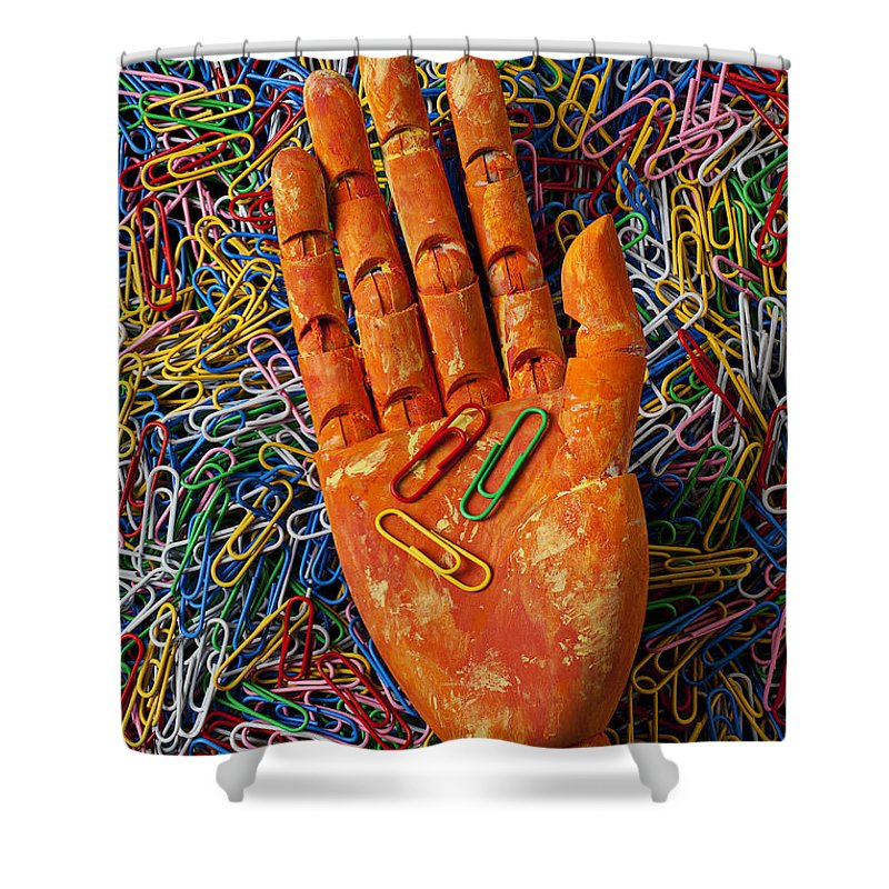 Orange Shower Curtain featuring the photograph Orange Wooden Hand Holding Paperclips by Garry Gay