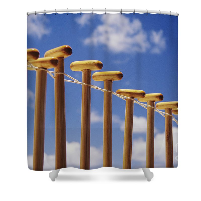 Air Shower Curtain featuring the photograph Paddles Hanging In A Row by Joss - Printscapes