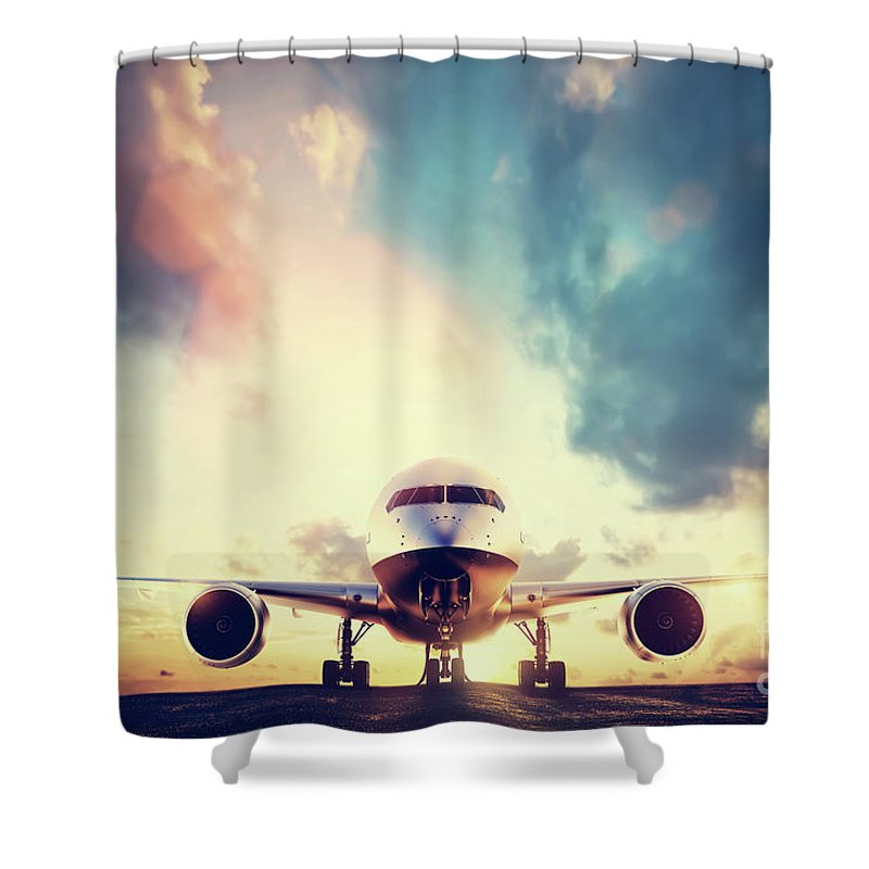 Airplane Shower Curtain featuring the photograph Passenger Airplane Taking Off On Runway At Sunset by Michal Bednarek